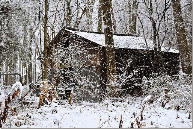 rustic barn in snow