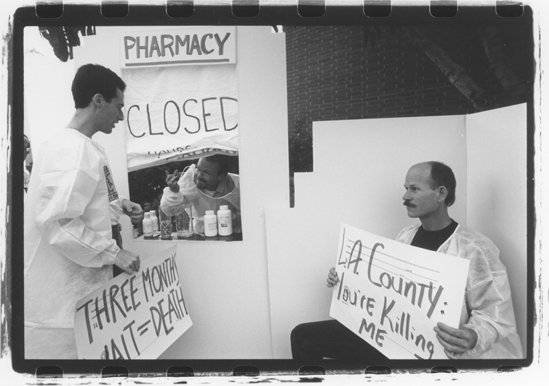 An ACT UP Los Angeles picket and performance at LAC/USC protesting the 3 month waiting list for HIV/AIDS medications. Undated.