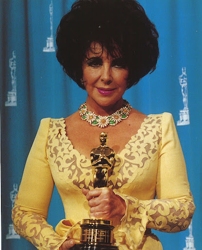 And here is Elizabeth wearing it!  (photo, Elizabeth Taylor:My Love Affair With Jewelry)