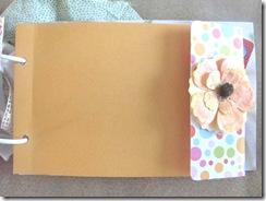 Cape Kellys birthday book orange envelope page with flower