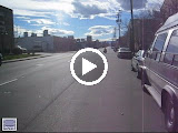 Kai and James riding a mini bike in Denver