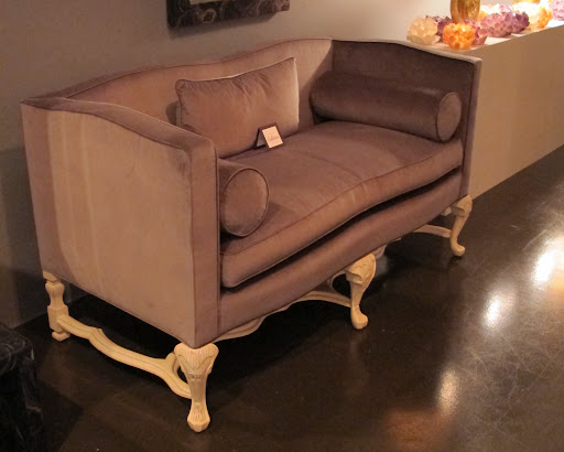 Isn't this little couch so sensual? The curves and hand-carved wood are almost regal in that mauve-y hue.