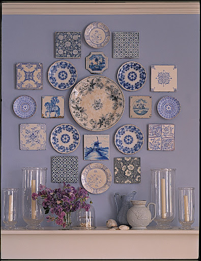 This collection of blue plates and tiles brings together a range of blues and becomes the focal point of the room.