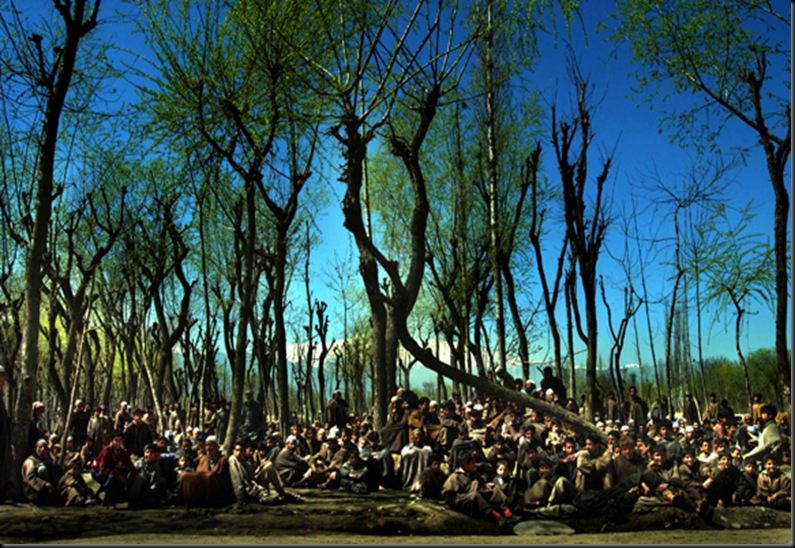 Hundreds of  villagers sit  outside their homes after Indian soldiers search for a militant, March 28, 2002  in Budgam district west of Srinagar. The militant hid in a mosque in a 20-hour siege. It was the fourth time in two months that separatists had sought refuge in a mosque in the Himalayan region. <br />