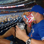 munching at a blluejays game in Toronto, Ontario, Canada