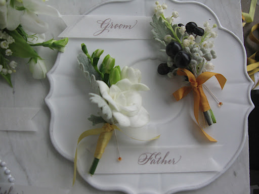 These boutonnieres will speak to your men (the dish is Astier de Villate).