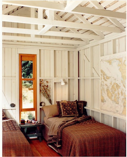 This is truly a fabulous interior. I love the white painted beams and large map print. (houzz.com)
