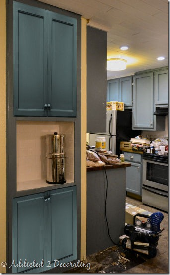 bookcase turned pantry with doors