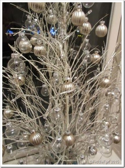 when dry i arranged them as best as i could into a christmas tree shape putting them back into the oasis placed in an off white pot with ornamental blue