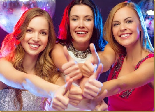 three women showing thumbs up