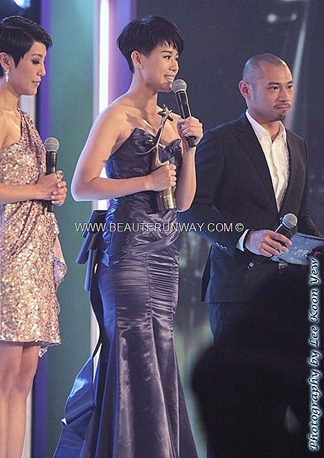 Starhub TVB Awards 2012 Myolie Wu Hong Kong Actress Celebrities My Favourite TVB Actress and My Favourite TVB Female Character Ghetto Justice Wong Sze Fu Singapore Media's favourite TVB Drama purple gown ribbon bow train sash bosco