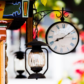 Colour by Ranajit Dey - Buildings & Architecture Other Exteriors ( arch, bhutan, clock, nice, resort, hotel, hanging lamp, old clock, colours )