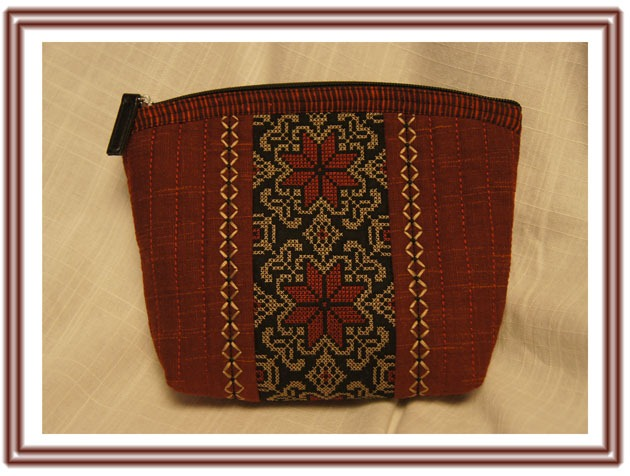 Cosmetic purse, decorated with cross stiches