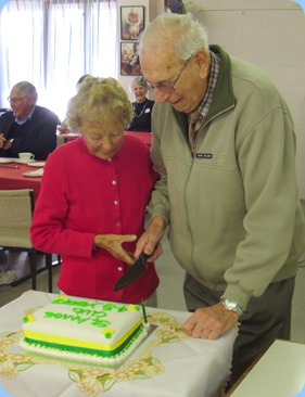 Dave Wilson and Ivy Kirker cutting the celebration cake for the 'Last Day Party'.