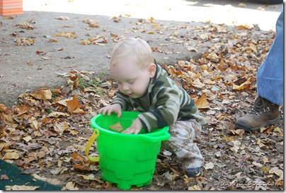 Mike playing with some leaves