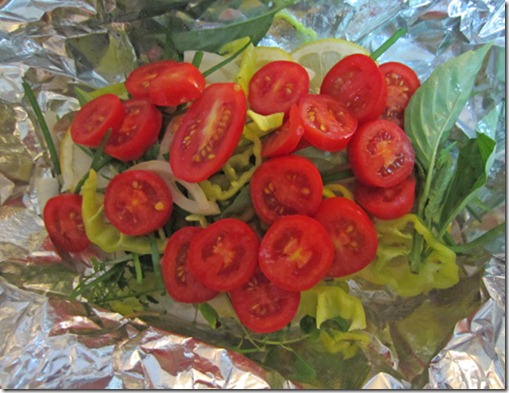 Foil-baked bluefish with tomatoes and herbs