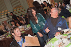 Guests conversing, including Tish Momirov and Allan Badiner.
