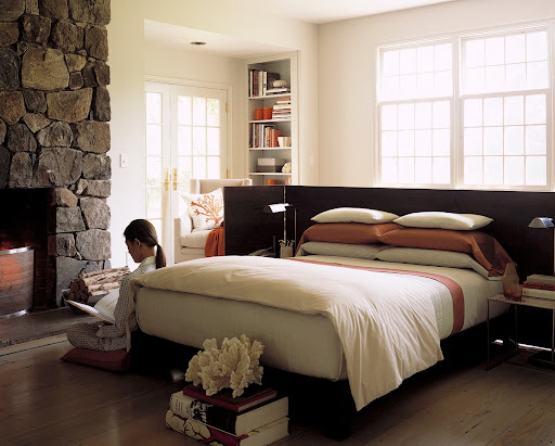 Such a simple idea: Attach a low, screen-like headboard to a platform bed. This allows you to either put the bed up against a wall or float it mid room.