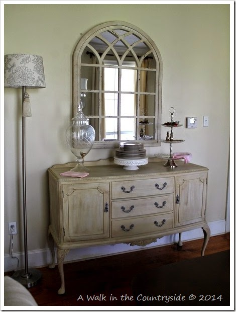 arched mirror over sideboard