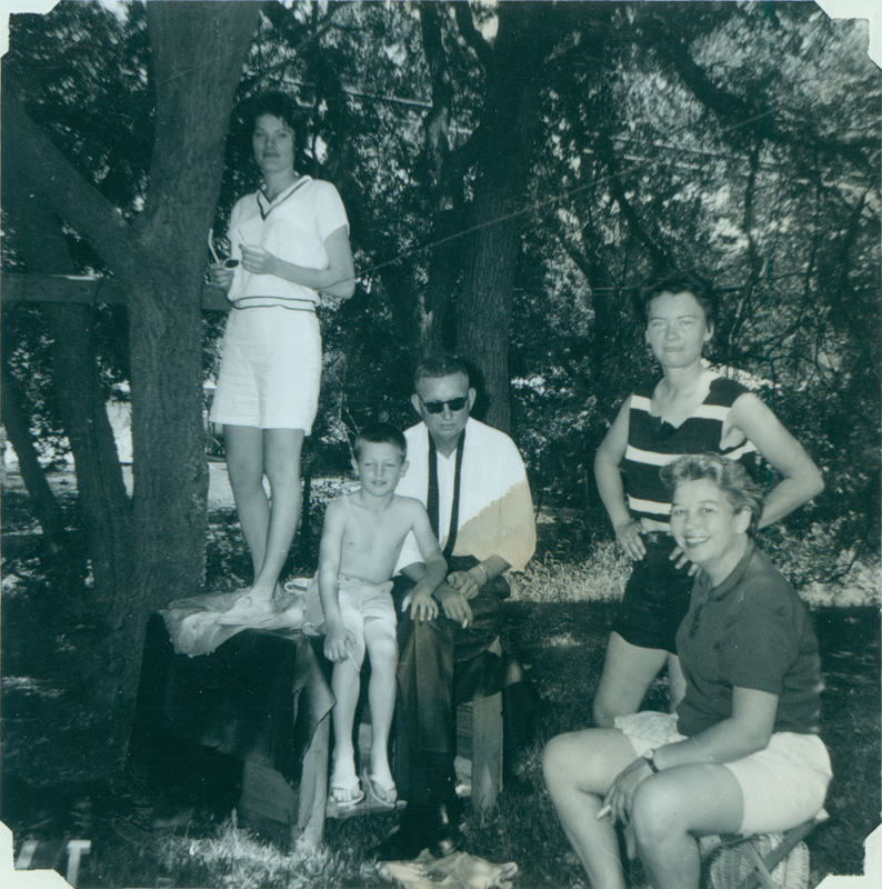 Carolyn Weathers, unknown boy, Ralph, Brenda Weathers and Dottie Frank the morning after the Fiesta in Brenda Weathers and Anita Ornales' backyard, 255 Claremont. 1962.