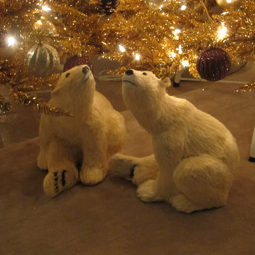 Grandin Road sells these polar bears that are in many different poses.