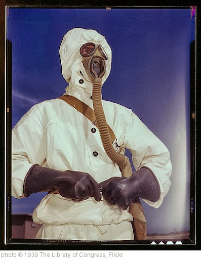 'Sailor at the Naval Air Base wears the new type protective clothing and gas mask designed for use in chemical warfare, Corpus Christi, Texas. These uniforms are lighter than the old type  (LOC)' photo (c) 1939, The Library of Congress - license: http://www.flickr.com/commons/usage/