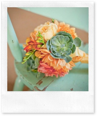 orange and teal flower