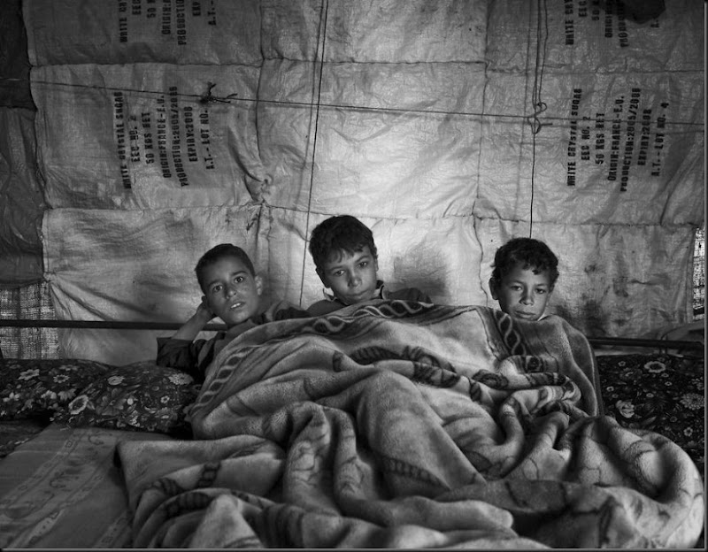 Syrian children waking up inside their tent in Lebanon's Bekaa Valley.  (Moises Saman/Magnum Photos for Save the Children)