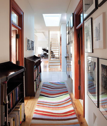 Use a colorful rug to greet your guests. (apartmenttherapy.com)