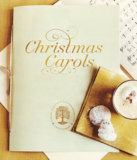 This is Martha's Christmas carol songbook in gold.  (marthastewart.com)