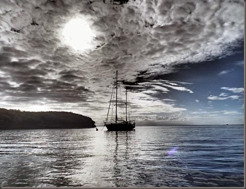 anchored sailboat at Sumilon Island travel blog