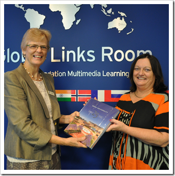 Wendy Abbott presents Yvonne Maher with the major lucky door prize.