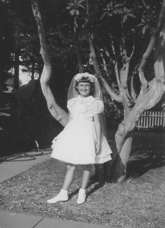 Lynn Edward Harris at 8 years old dressed for her 1st communion. November 1958.