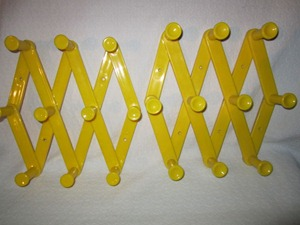 yellow plastic clothes hanger