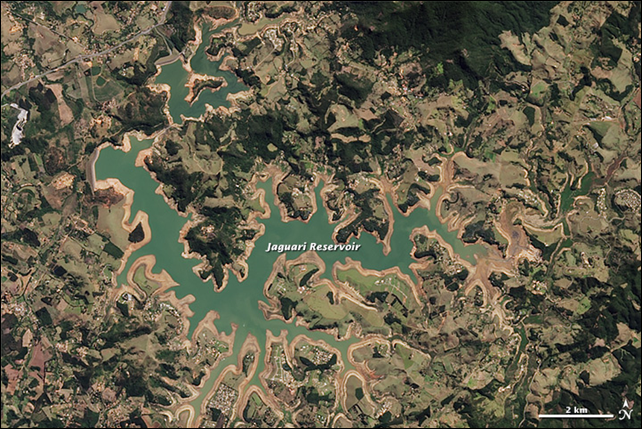 Satellite view of the Jaguari Reservoir in Southeastern Brazil, 3 August 2014. Southeastern Brazil is suffering through one of its worst droughts in decades. The situation is worst near the city of São Paulo (home to about 20 million people) and in São Paulo state. Rainfall totals for the year are 300 to 400 millimeters (12 to 16 inches) below normal, and reservoirs have dwindled to 3 to 5 percent of storage capacity. Photo: Jesse Allen