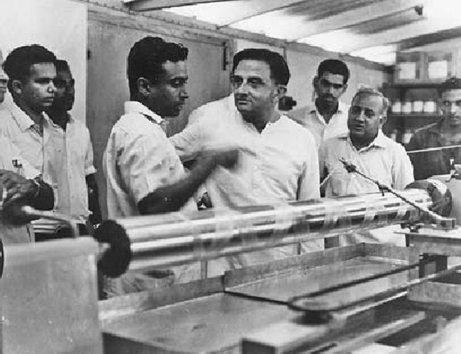 Dr. Vikram Sarabhai listening to a young Dr. APJ Kalam as he speaks, while Dr. Madhavan Nair, later ISRO Chair man looks on