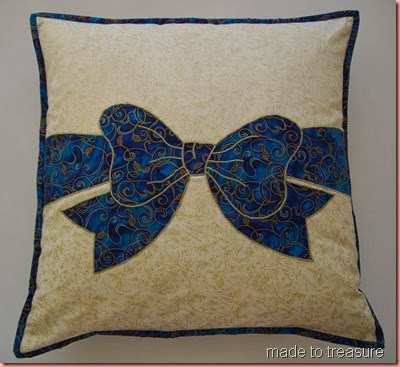 blue applique pillow