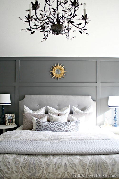 paneled wall behind bed