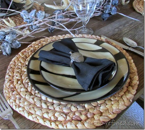 Modern take on a rustic tablescape using antlers and zebra print