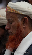 I like his henna-dyed beard. Friday prayer on 60 Meter Rd, Sana&#039;a, Yemen        