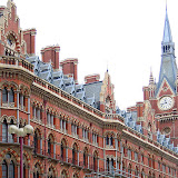 The ornate Gothic Revival facade and clock tower of Sir George Gilbert Scott's Midland Hotel