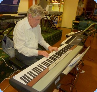 Ian Jackson playing the Korg SP-250 piano. Photo courtesy of Colleen Kerr.