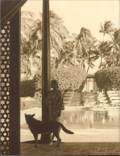Here's Doris at her Honolulu residence, Shangri La.  A salt water pool and exotic gardens decorated her outdoor living space, but I'm focused on the carved door frame in the near left of the photo.