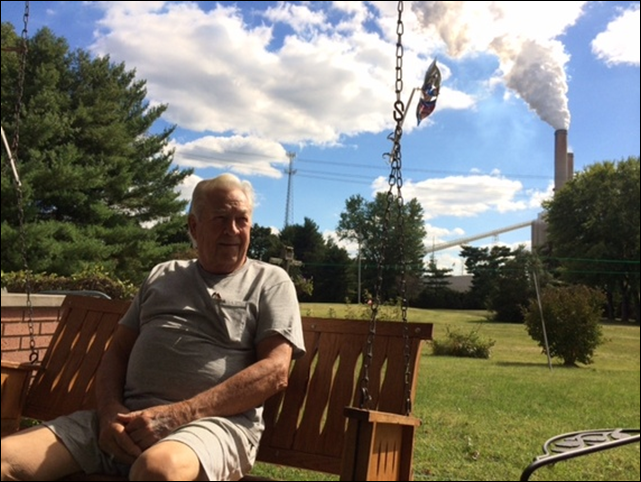 The former mayor of Cheshire, Scotty Lucas, 81, at his home, with the Gavin power plant in the background. Scotty Lucas is the former mayor of a town that no longer exists. This riverside village became briefly famous in 2002, when American Electric Power, the utility that operates two large coal-fired power plants here, bought it for $20 million — a deal the company preferred over dealing with residents' ongoing complaints about air pollution. Photo: Richard Martin