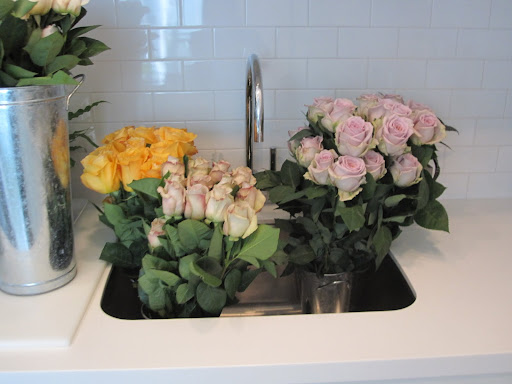 More roses wait to be used for table arrangements.