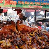 Urumqi - Marché de rue, le hacheur de volaille