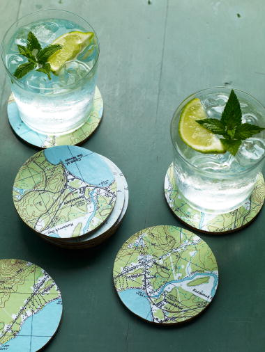 Maps can be transformed into playful coasters. (Martha Stewart Living, August 2009)