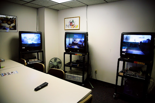 Each television displays a different counseling room so sessions can be monitored.  (Photo Credit: Alex Crowder)