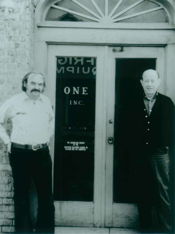 Jim Kepner (left) and W. Dorr Legg standing outside the ONE Incorporated offices on Venice Blvd. Undated.