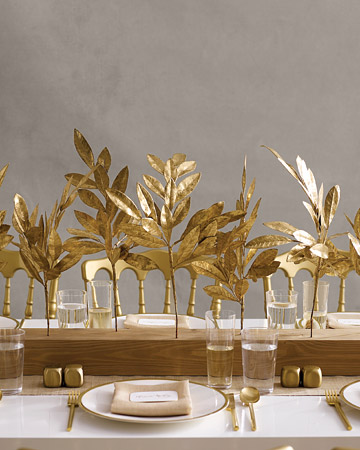 Juxtapose opulent gold branches (in the form of faux bay-laurel twigs) with the humble grace of wood. (marthastewartweddings.com)